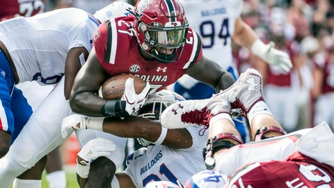 South Carolina running back Ty'Son Williams (27) carries the ball against Louisiana Tech linebacker Russell Farris (31) during the first half of an NCAA college football game Saturday, Sept. 23, 2017, in Columbia, S.C. (AP Photo/Sean Rayford)