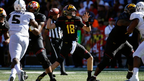 Maryland quarterback Max Bortenschlager (18) throws to a receiver in the first half of an NCAA college football game against Central Florida in College Park, Md., Saturday, Sept. 23, 2017. (AP Photo/Patrick Semansky)