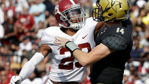 Alabama defensive back Minkah Fitzpatrick (29) hits the arm of Vanderbilt quarterback Kyle Shurmur (14) to cause an incomplete pass in the first half of an NCAA college football game Saturday, Sept. 23, 2017, in Nashville, Tenn. (AP Photo/Mark Humphrey)