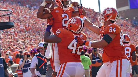 Clemson's Kelly Bryant (2) celebrates a touchdown with Christian Wilkins (42) and Cannon Smith during the first half of an NCAA college football game against Boston College, Saturday, Sept. 23, 2017, in Clemson, S.C. (AP Photo/Richard Shiro)