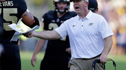 Purdue head coach Jeff Brohm yells to an official during the first half of an NCAA college football game against the Michigan in West Lafayette, Ind., Saturday, Sept. 23, 2017. (AP Photo/Michael Conroy)