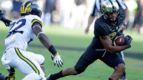 Purdue safety Navon Mosley (27) cuts away from Michigan running back Karan Higdon (22) after making an interception during the first half of an NCAA college football game in West Lafayette, Ind., Saturday, Sept. 23, 2017. (AP Photo/Michael Conroy)