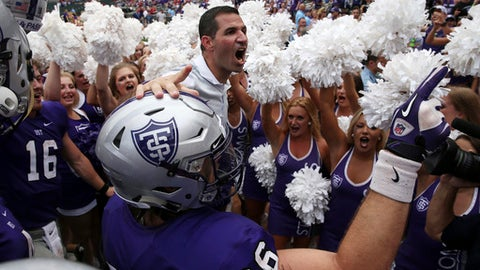 St. Thomas coach Glenn Caruso celebrates with his team after their win over St. John's in an NCAA college football game Saturday, Sept. 23, 2017, in Minneapolis. (Anthony Souffle/Star Tribune via AP)