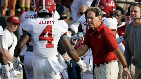 Alabama head coach Nick Saban congratulates wide receiver Jerry Jeudy (4) after Jeudy scored a touchdown against Vanderbilt in the second half of an NCAA college football game Saturday, Sept. 23, 2017, in Nashville, Tenn. (AP Photo/Mark Humphrey)
