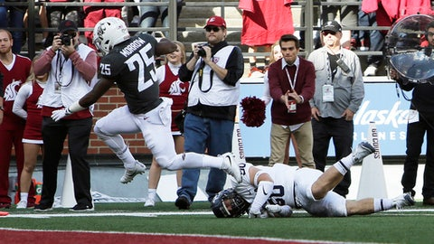 Washington State running back Jamal Morrow (25) runs for a touchdown while defended by Nevada linebacker Austin Paulhus (50) during the first half of an NCAA college football game in Pullman, Wash., Saturday, Sept. 23, 2017. (AP Photo/Young Kwak)