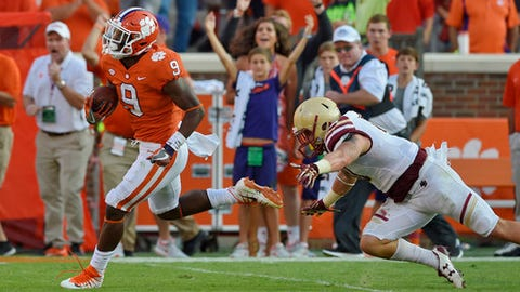 Clemson freshman running back Travis Etienne avoids the tackle by Boston College's Ty Schwab to score a 50 yard touchdown during the second half of an NCAA college football game, Saturday, Sept. 23, 2017, in Clemson, S.C. Clemson won 34-7. (AP Photo/Richard Shiro)