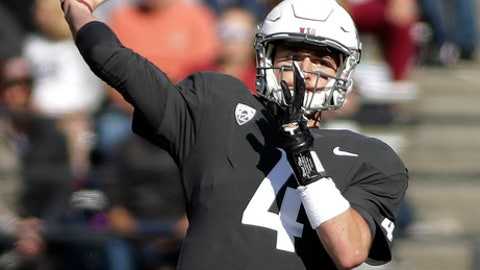 Washington State quarterback Luke Falk (4) throws a pass during the first half of an NCAA college football game against Nevada in Pullman, Wash., Saturday, Sept. 23, 2017. (AP Photo/Young Kwak)