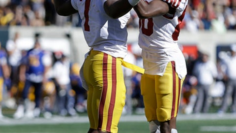 Southern California's Stephen Carr, left, celebrates with Deontay Burnett after scoring a touchdown against California during the second half of an NCAA college football game Saturday, Sept. 23, 2017, in Berkeley, Calif. (AP Photo/Ben Margot)