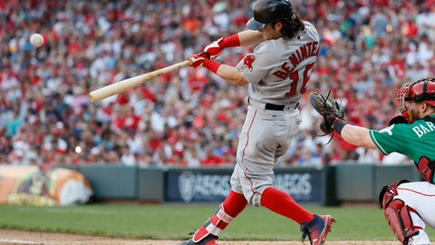 Boston Red Sox's Andrew Benintendi hits an RBI single off Cincinnati Reds starting pitcher Amir Garrett in the seventh inning of a baseball game, Saturday, Sept. 23, 2017, in Cincinnati. (AP Photo/John Minchillo)