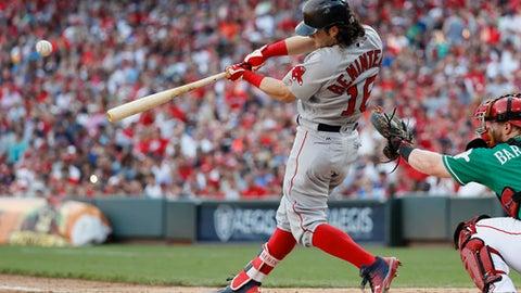 Boston Red Sox's Andrew Benintendi hits an RBI single off Cincinnati Reds starting pitcher Amir Garrett in the seventh inning of a baseball game, Saturday, Sept. 23, 2017, in Cincinnati. (AP Photo/John Minchillo)