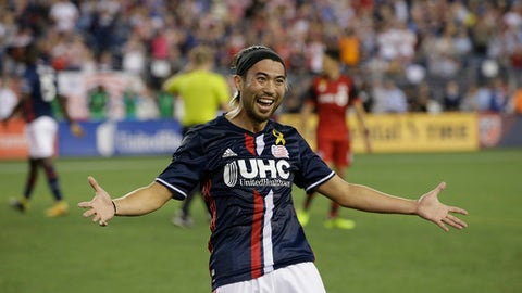 New England Revolution midfielder Lee Nguyen (24) celebrates with fans after he assisted on his team's second goal against Toronto FC during the second half of an MLS soccer match Saturday, Sept. 23, 2017, in Foxborough, Mass.(AP Photo/Stephan Savoia)