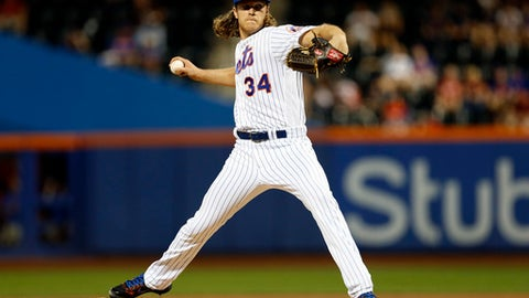 New York Mets pitcher Noah Syndergaard throws during the first inning of a baseball game against the Washington Nationals on Saturday, Sept. 23, 2017, in New York. (AP Photo/Adam Hunger)