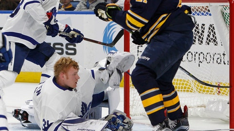 Toronto Maple Leafs goalie Frederik Anderson (31) gets his mask knocked off during the first period of a preseason NHL hockey game against the Buffalo Sabres, Saturday Sept. 23, 2017, in Buffalo, N.Y. (AP Photo/Jeffrey T. Barnes)