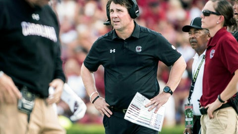 South Carolina head coach Will Muschamp looks at the video screen during the first half of an NCAA college football game against Louisiana Tech on Saturday, Sept. 23, 2017, in Columbia, S.C. South Carolina defeated Louisiana Tech 17-16. (AP Photo/Sean Rayford)
