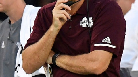 Mississippi State coach Dan Mullen watches play against Georgia during the first of an NCAA college football game, Saturday, Sept. 23, 2017, in Athens, Ga. (AP Photo/Mike Stewart)