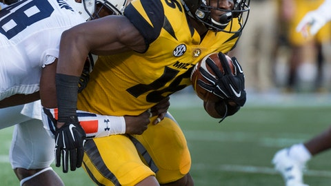 Missouri running back Damarea Crockett, right, is wrapped up by Auburn's Montavious Atkinson, left, during the first quarter of an NCAA college football game Saturday, Sept. 23, 2017, in Columbia, Mo. (AP Photo/L.G. Patterson)