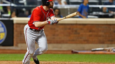 Washington Nationals' Daniel Murphy watches his solo home run during the 10th inning of a baseball game against the New York Mets on Saturday, Sept. 23, 2017, in New York. (AP Photo/Adam Hunger)
