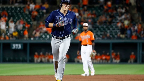 Tampa Bay Rays' Logan Morrison, foreground, rounds the bases after hitting a solo home run in the ninth inning of a baseball game against the Baltimore Orioles in Baltimore, Saturday, Sept. 23, 2017. (AP Photo/Patrick Semansky)