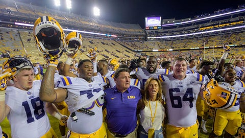 LSU head coach Ed Orgeron, center, celebrates LSU's 35-26 victory against Syracuse in an NCAA college football game in Baton Rouge, La., Saturday, Sept. 23, 2017. (AP Photo/Matthew Hinton)