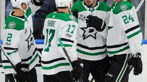 Dallas Stars' Roope Hintz (24), of Finland; Devin Shore (17); and Dan Hamhuis (2) congratulate Remi Elie (40) after his goal against the St. Louis Blues during the third period of an NHL preseason hockey game, Saturday, Sept. 23, 2017, in St. Louis. The Stars won 4-0. (AP Photo/Bill Boyce)