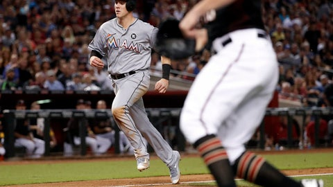 Miami Marlins' Brian Anderson scores on a groundout by Dee Gordon during the seventh inning of a baseball game against he Arizona Diamondbacks, Saturday, Sept. 23, 2017, in Phoenix. (AP Photo/Matt York)