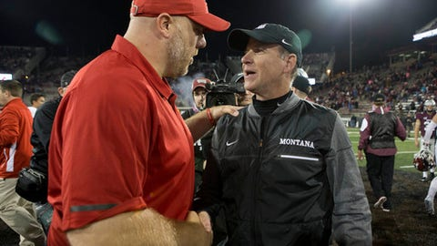 Montana coach Bob Stitt, right, shakes hands with Eastern Washington coach Aaron Best after an NCAA college football game Saturday, Sept. 23, 2017, in Missoula, Mont. Eastern Washington won 48-41. (AP Photo/Patrick Record)