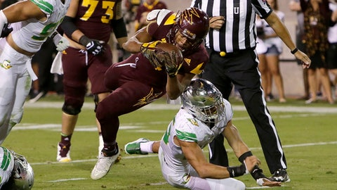 Arizona State running back Demario Richard (4) scores a touchdown over Oregon linebacker Troy Dye during the second half of an NCAA college football game, Saturday, Sept. 23, 2017, in Tempe, Ariz. (AP Photo/Rick Scuteri)