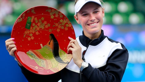 Caroline Wozniacki of Denmark poses with the winner's plate after beating Anastasia Pavlyuchenkova of Russia at the Pan Pacific Open tennis tournament in Tokyo, Sunday, Sept. 24, 2017. (AP Photo/Shizuo Kambayashi)