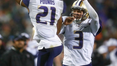 Washington wide receiver Quinten Pounds, left, celebrates his touchdown catch with quarterback Jake Browning during the second half against Colorado in an NCAA college football game Saturday, Sept. 23, 2017, in Boulder, Colo. Washington won 37-10. (AP Photo/David Zalubowski)