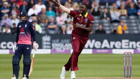 West Indies' Jason Holder celebrates after taking the wicket of England's Eoin Morgan during the third One Day International against West Indies at Bristol County Ground, England, Sunday Sept. 24, 2017. (David Davies/PA via AP)