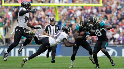 Jacksonville Jaguars wide receiver Marqise Lee (11) runs against the Baltimore Ravens defense during the first half of an NFL football game at Wembley Stadium in London, Sunday Sept. 24, 2017. (AP Photo/Matt Dunham)
