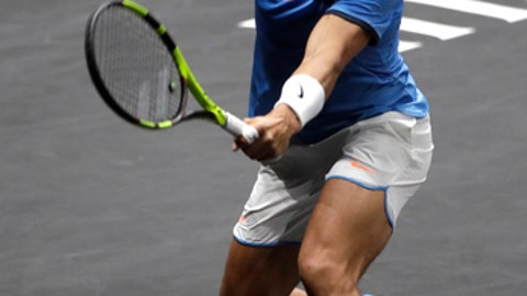Europe's Rafael Nadal returns a ball to World's John Isner during their Laver Cup tennis match in Prague, Czech Republic, Sunday, Sept. 24, 2017. (AP Photo/Petr David Josek)