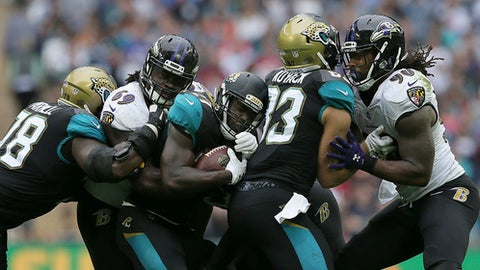 Jacksonville Jaguars running back Leonard Fournette, center, runs against the Baltimore Ravens during the second half of an NFL football game at Wembley Stadium in London, Sunday Sept. 24, 2017. (AP Photo/Tim Ireland)