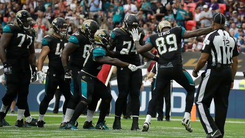 Jacksonville Jaguars running back Leonard Fournette, center, indulges in a celebration routine with Marcedes Lewis (89) after scoring a touchdown against the Baltimore Ravens during the second half of an NFL football game at Wembley Stadium in London, Sunday Sept. 24, 2017. (AP Photo/Matt Dunham)