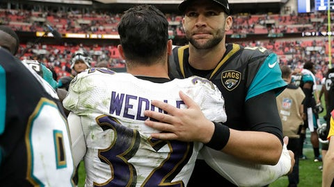 Jacksonville Jaguars quarterback Blake Bortles, right, greets Baltimore Ravens free safety Eric Weddle after an NFL football game at Wembley Stadium in London, Sunday Sept. 24, 2017. The Jaguars won 44-7. (AP Photo/Matt Dunham)