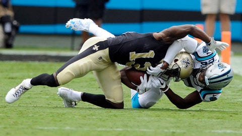 New Orleans Saints' Michael Thomas (13) is tackled after a catch by Carolina Panthers' Daryl Worley (26) in the first half of an NFL football game in Charlotte, N.C., Sunday, Sept. 24, 2017. (AP Photo/Mike McCarn)