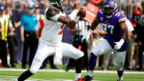 Tampa Bay Buccaneers quarterback Jameis Winston, left, runs from Minnesota Vikings defensive end Everson Griffen (97) during the first half of an NFL football game, Sunday, Sept. 24, 2017, in Minneapolis. (AP Photo/Bruce Kluckhohn)