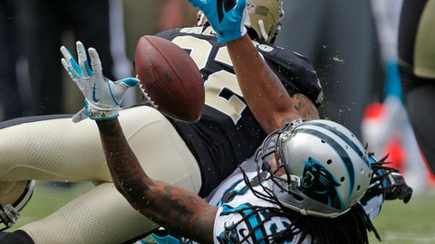 Carolina Panthers' Kelvin Benjamin (13) reaches for the ball as New Orleans Saints' Kenny Vaccaro (32) defends in the first half of an NFL football game in Charlotte, N.C., Sunday, Sept. 24, 2017. (AP Photo/Bob Leverone)