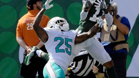 Miami Dolphins cornerback Xavien Howard (25) and New York Jets wide receiver Robby Anderson (11) fight for the ball in the end zone during the first half of an NFL football game Sunday, Sept. 24, 2017, in East Rutherford, N.J. (AP Photo/Bill Kostroun)