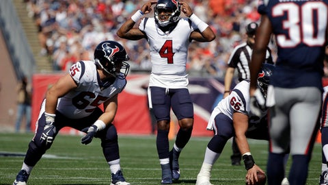 Houston Texans quarterback Deshaun Watson (4) gives signals at the line of scrimmage during the first half of an NFL football game against the New England Patriots, Sunday, Sept. 24, 2017, in Foxborough, Mass. (AP Photo/Steven Senne)