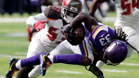 Minnesota Vikings running back Dalvin Cook (33) is tackled by Tampa Bay Buccaneers outside linebacker Adarius Glanton (53) during the first half of an NFL football game, Sunday, Sept. 24, 2017, in Minneapolis. (AP Photo/Jim Mone)