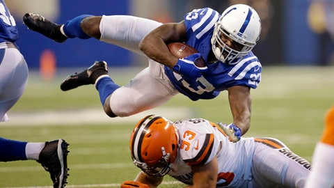 Indianapolis Colts running back Frank Gore (23) goes over Cleveland Browns middle linebacker Joe Schobert (53) during the first half of an NFL football game in Indianapolis, Sunday, Sept. 24, 2017. (AP Photo/AJ Mast)
