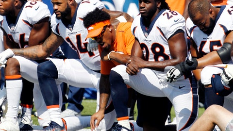 Denver Broncos players, including Jamaal Charles (28) kneel during the national anthem prior to an NFL football game against the Buffalo Bills, Sunday, Sept. 24, 2017, in Orchard Park, N.Y. (AP Photo/Jeffrey T. Barnes)