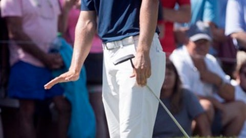 Jordan Spieth reacts to his putt on the first green during the final round of the Tour Championship golf tournament at East Lake Golf Club in Atlanta, Sunday, Sept. 24, 2017, in Atlanta. (AP Photo/John Amis)