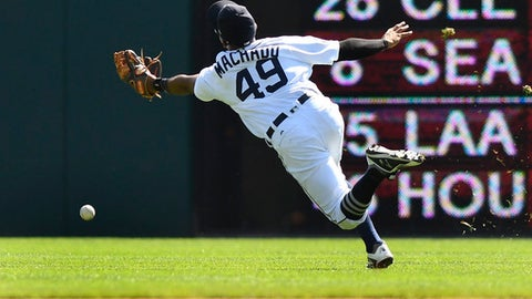 Detroit Tigers second baseman Dixon Machado (49) can not reach the ball during the sixth inning of a baseball game against the Minnesota Twins, Sunday, Sept. 24, 2017, in Detroit. (AP Photo/Jose Juarez)