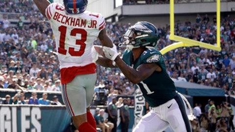 New York Giants' Odell Beckham, left, catches a touchdown pass against Philadelphia Eagles' Jalen Mills during the second half of an NFL football game, Sunday, Sept. 24, 2017, in Philadelphia. (AP Photo/Matt Rourke)