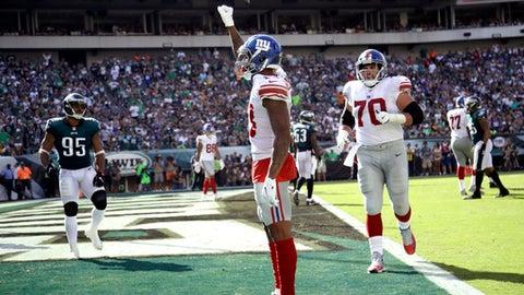 New York Giants' Odell Beckham celebrates after a touchdown during the second half of an NFL football game against the Philadelphia Eagles, Sunday, Sept. 24, 2017, in Philadelphia. (AP Photo/Matt Rourke)