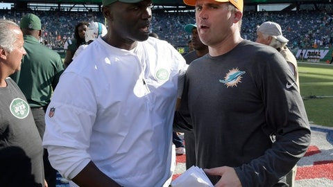 Miami Dolphins head coach Adam Gase, right, shakes hands with New York Jets head coach Todd Bowles after an NFL football game, Sunday, Sept. 24, 2017, in East Rutherford, N.J. The Jets won 20-6. (AP Photo/Bill Kostroun)
