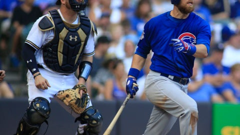 Chicago Cubs' Ben Zobrist watches his two-run home run against the Milwaukee Brewers during the seventh inning of an baseball game Sunday, Sept. 24, 2017, in Milwaukee. (AP Photo/Darren Hauck)