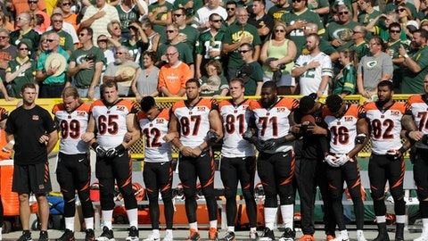The Cincinnati Bengals lock arms during the national anthem before an NFL football game against the Green Bay Packers Sunday, Sept. 24, 2017, in Green Bay, Wis. (AP Photo/Morry Gash)